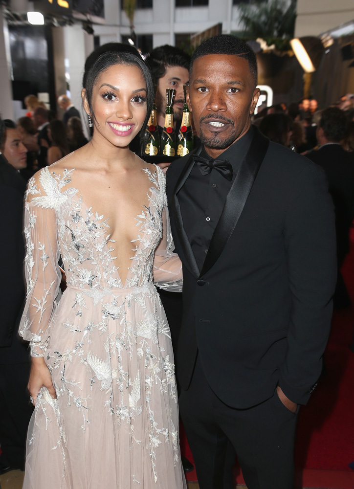 BEVERLY HILLS, CA - JANUARY 10: Miss Golden Globes 2016, Corinne Bishop and actor Jamie Foxx attend the 73rd Annual Golden Globe Awards held at the Beverly Hilton Hotel on January 10, 2016 in Beverly Hills, California. (Photo by Joe Scarnici/Getty Images for Moet & Chandon)