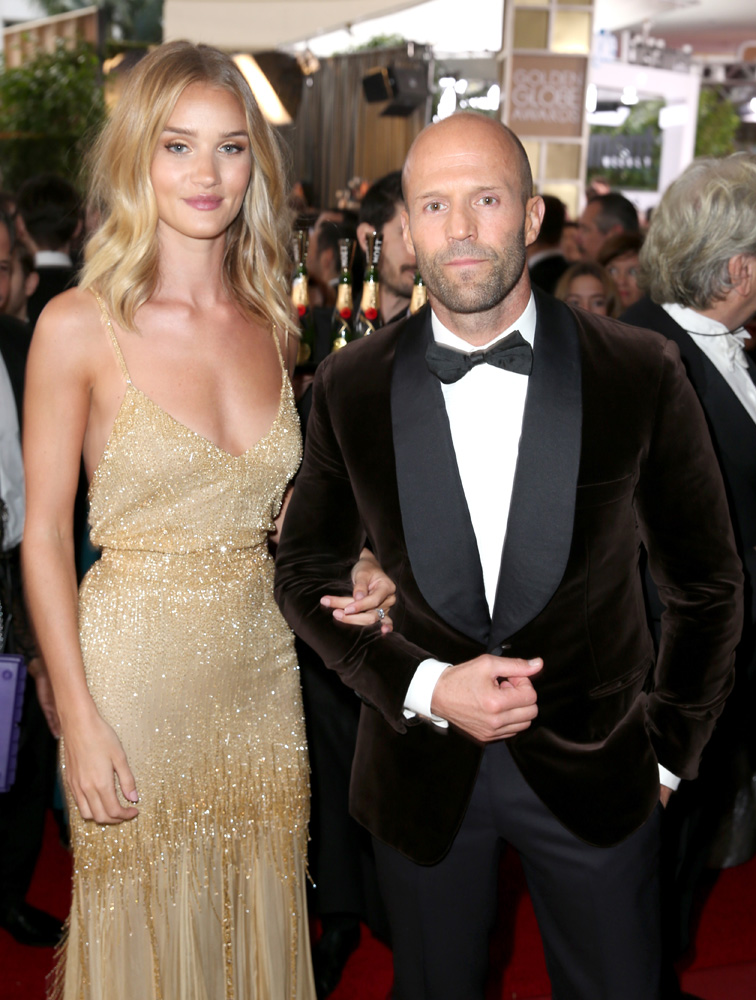 BEVERLY HILLS, CA - JANUARY 10: Actors Rosie Huntington-Whiteley (L) and Jason Statham attend the 73rd Annual Golden Globe Awards held at the Beverly Hilton Hotel on January 10, 2016 in Beverly Hills, California. (Photo by Joe Scarnici/Getty Images for Moet & Chandon)